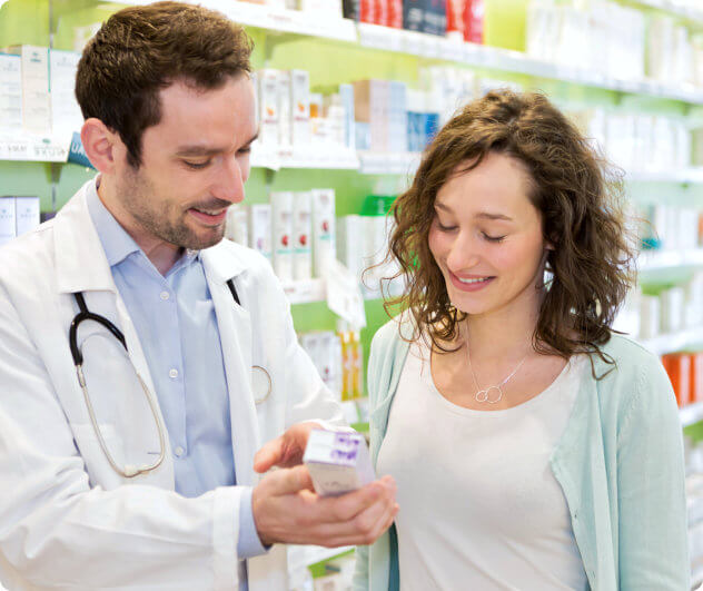 pharmacist smiling with patient